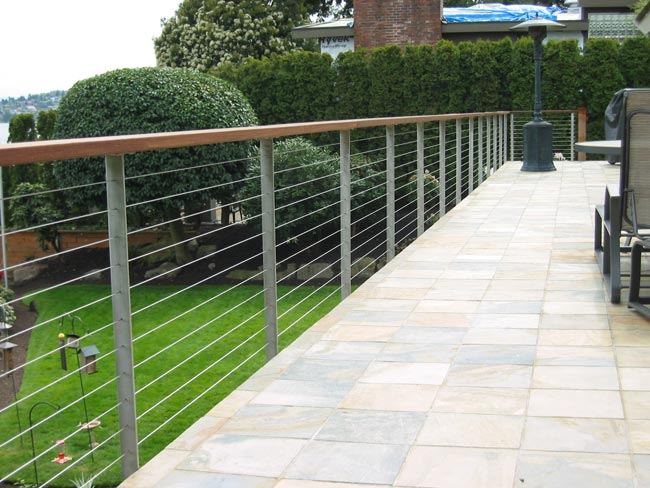 Cable railing done in stainless posts and Ironwood (Ipe) top rail.